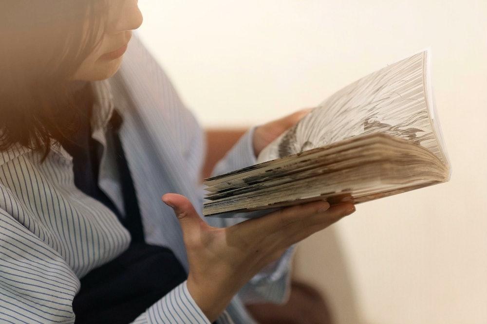 Image of a person reading manga